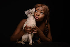 Cat and owner on black background Royalty Free Stock Photography