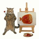 Cat draws a picture on the easel 2. The cat painter is drawing a piece of sausage on the easel. White background stock image