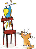 Cat and parrot. Cat and big parrot sitting on a chair Royalty Free Stock Photography