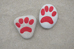 Cat paw concept on carved stones Stock Photos