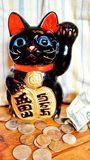 Cat penny bank. Cermanic chinese japenise bobtail art crafts saving Stock Images