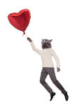 Cat people flying holding a balloon in the shape o Stock Photography