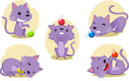 Cat playing with a ball action set Stock Images