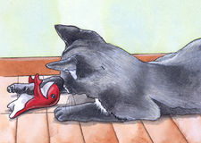 Cat playing with a toy. A nice little cat plays with a red toy royalty free illustration