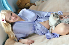 Cat and pregnant woman Stock Images