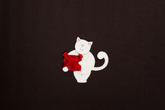 Cat with red box applique. Сute paper cat with red gift box on texture background Royalty Free Stock Photo