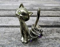 Cat ring holder with silver rings in it`s tail Royalty Free Stock Images