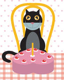 Cat's birthday celebration. A black cat is sitting on a table and ready to blow his birthday cake Stock Images