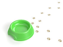 Cat's bowl. An empty bowl and cat's tracks  on white background with clipping path Royalty Free Stock Images