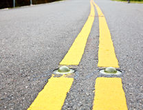 Road marking. Cat's eye road marking close-up Royalty Free Stock Images