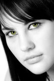 Cat's eyes. Black and white photo of a darkhaired girl with green eyes Stock Images