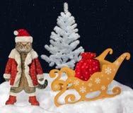 Cat Santa Claus near the sleigh stock photography