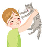 Cat Scratching Boy Stock Photos