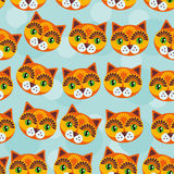 Cat Seamless-Muster mit lustigem nettem Tiergesicht auf einem blauen backg Lizenzfreies Stockbild
