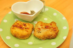 Cat-shaped chicken nuggets. And cute dessert plate Royalty Free Stock Photos