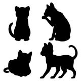 Cat silhouettes. Set of four cat silhouettes vector illustration