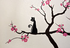 Cat sitting on a blooming sakura branch (wallpaper painting) Royalty Free Stock Photo