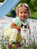 Cat and small girl Stock Images