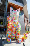 Cat statue in front of a Hello Kitty House in Bangkok, Thailand Stock Photography