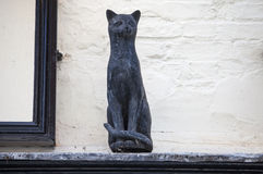 Cat Statue in York. One of the decorative cat statues that are placed on numerous buildings in York, England royalty free stock photography