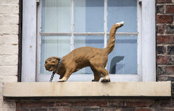 Cat Statue in York. One of the decorative cat statues that are placed on numerous buildings in York, England stock photos