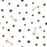 Cat theme seamless background. Cat theme seamless pattern with heart shaped animal paw footprints and fish bones Stock Photography
