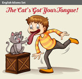 A cat touching a boy's tongue Stock Photo