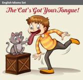 A cat touching a boy's tongue Stock Photo