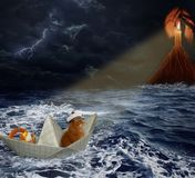 Cat sailor in storm. A cat is traveling on a paper ship. There is a storm at sea. It sees a lighthouse royalty free stock image
