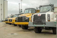 CAT trucks at Southampton docks. SOUTHAMPTON, UK - MAY 31, 2014: A row of brand new CAT articulated trucks, made by Caterpillar parked at the dockside in Stock Image