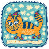 Cat walks in the snow. Yellow Cat in the cap with big eyes in socks winter walks in the snow Royalty Free Stock Image