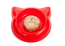 Cat wet food in a red bowl isolated on white. Royalty Free Stock Image