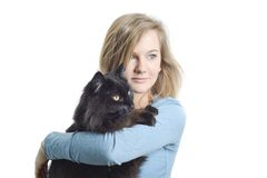 Cat and Woman. Black cat and blonde woman with blue eyes looking right Royalty Free Stock Images