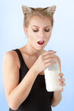 Cat-woman drinking milk Royalty Free Stock Photos