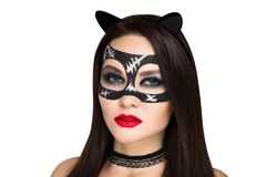 Cat woman makeup. Young beautiful bright showy girl lady model sexy cat. Fairy tale future party cosplay club. new makeup flawless face dark eyes cheeks eyebrows Royalty Free Stock Image