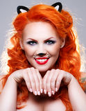 Cat woman with red hair Royalty Free Stock Photos