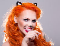 Cat woman with red hair Royalty Free Stock Photography