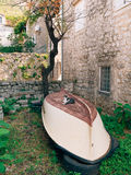 Cat on a wooden fishing boat, upside down, in Perast, Montenegro.  Royalty Free Stock Photography