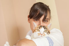 Cat and young woman Stock Images