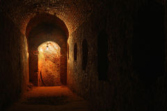 Catacombs. Well lit catacombs of the castle in Dubno, Ukraine Royalty Free Stock Photography