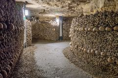 Catacombs, tunnels, walls made of bones and skulls Stock Image