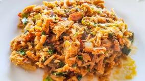Catado de siri: brazilian food made of crab meat in a white plate in a close view. Catado de siri: brazilian food made of crab meat in a white plate in a close royalty free stock image