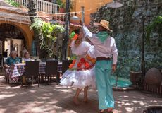 Dancers Perform in Traditional Garb. Catagena, Columbia--April 21, 2018. Dancers in traditional garb perform a dance in a restaurant. Editorial use only royalty free stock images