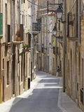 Catalan alley. Alley in the historic centre of Torroella de Montgri, Catalonia, Spain Royalty Free Stock Photo