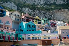 Catalan Bay, East side of Gibraltar. Gibraltar, United Kingdom, 2nd October 2018:- Colourful buildings along the seafront in Catalan Bay, Gibraltar. Gibraltar is stock photo