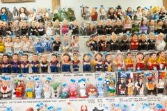 Catalan caganers på räknare av julmarknaden arkivbild