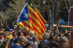 Catalan demonstrators with national catalan symbols in Barcelona to support the freedom of the political prisoners. More than 300.000 people have participated Stock Images