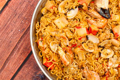 Catalan Fideua. A traditional seafood dish from north east Spain similar to paella but made with short lengths of pasta instead of rice Stock Images