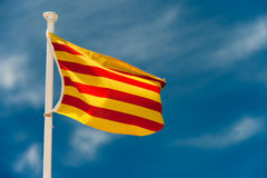 Catalan flag. Blowing in the wind with blue sky Royalty Free Stock Photo