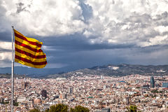 Catalan flag. On the background of Barcelona Stock Photos